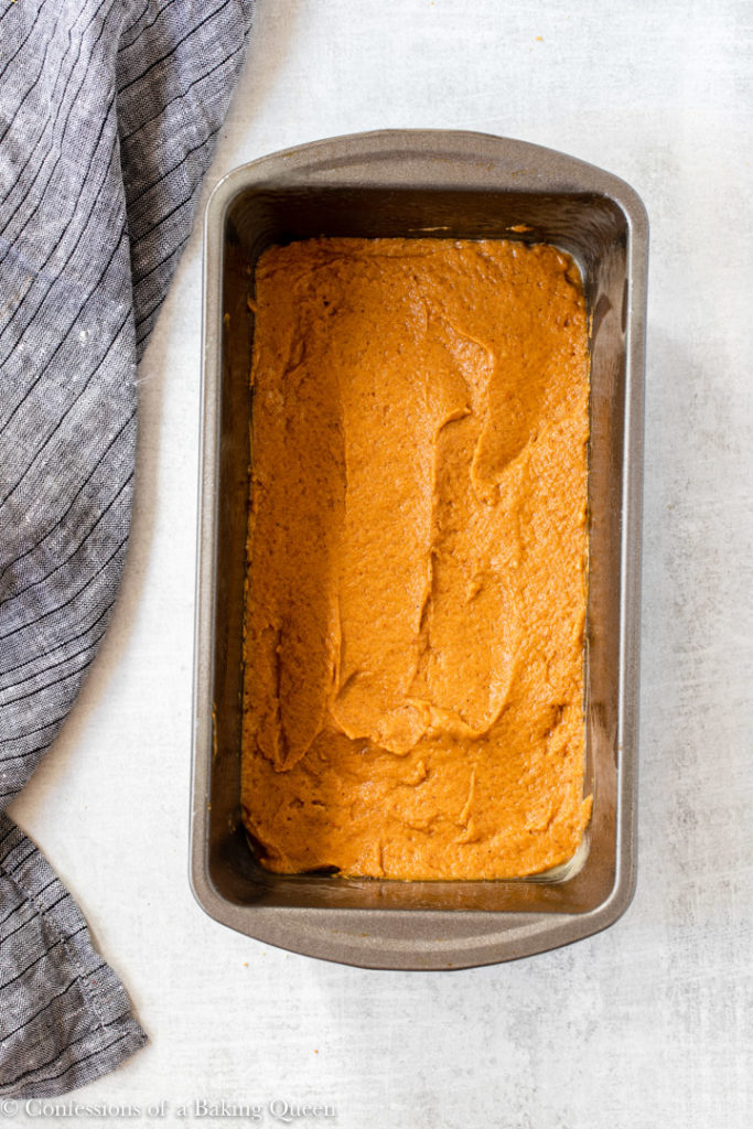 pumpkin batter spread into the bottom of a loaf pan