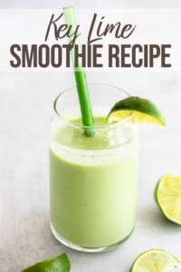 key lime smoothie with a lime wedge in a short glass