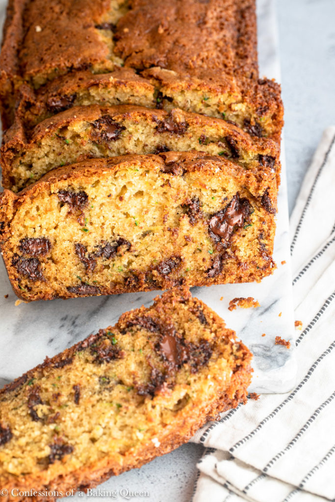 chocolate chip zucchini bread sliced on a marble board