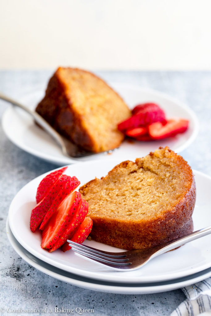 two pieces of crack cake recipe on a white plate with strawberries