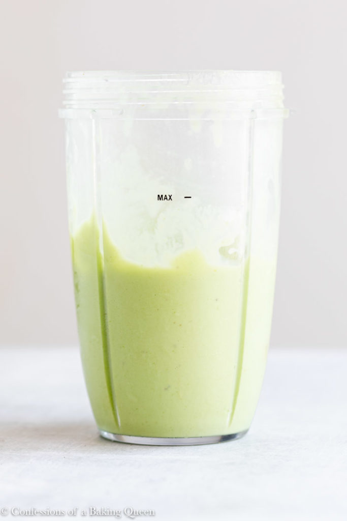 key lime smoothie in a plastic cup on a light surface