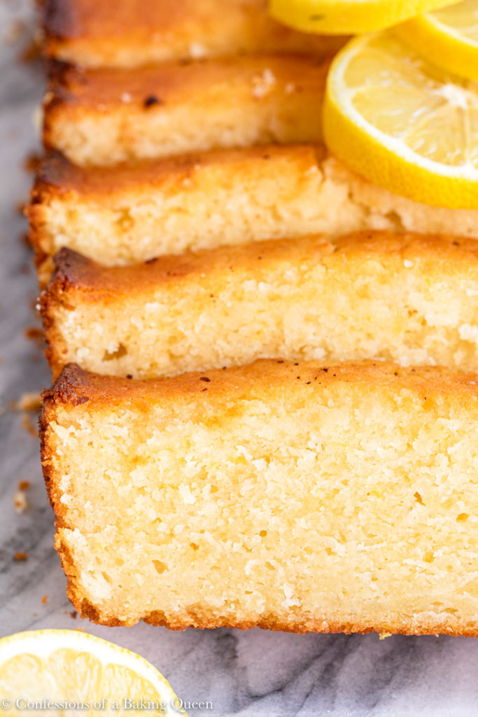 close up of lemon pound cake slices on a marble surface