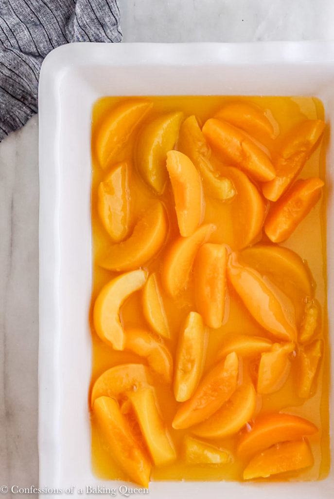 peaches in a white dish