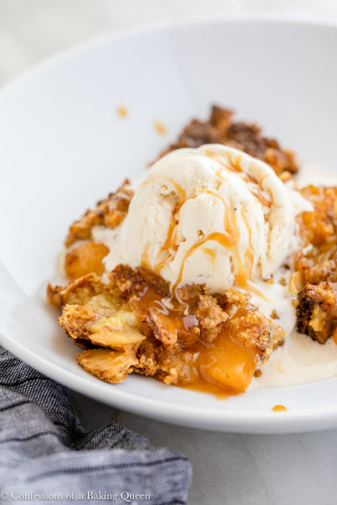 ice cream and caramel on top of peach dump cake recipe