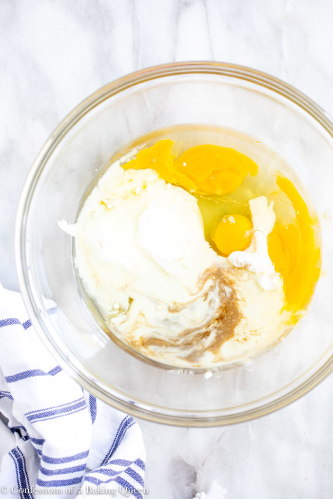 eggs, sour cream, buttermilk and vanilla extract in a large glass bowl
