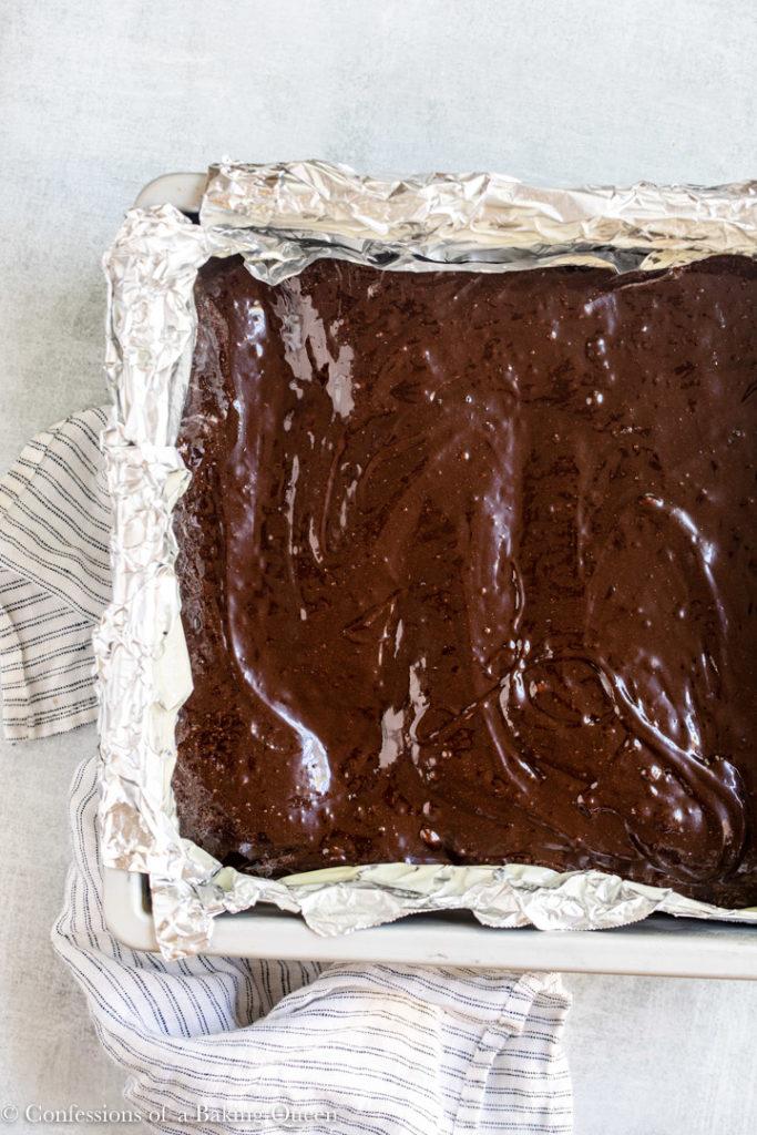 brownie batter in a metal pan