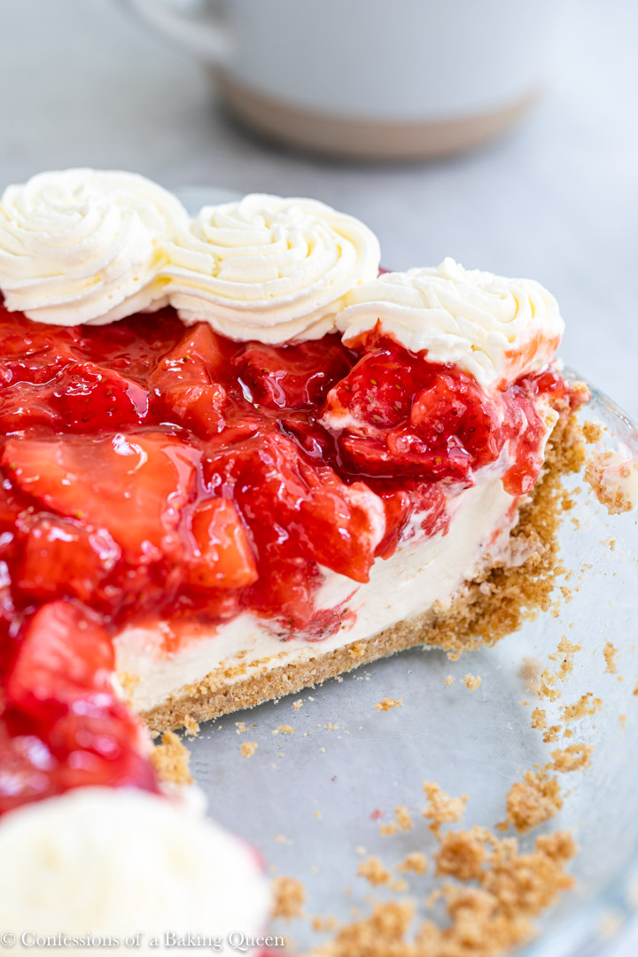 strawberry cream cheese pie with a slice missing