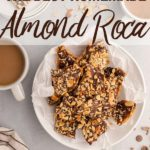 overhead view of almond roca in a bowl next to coffee cups and chocolate and almond pieces