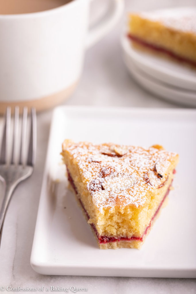 bakwell tart slice half eaten on a white plate