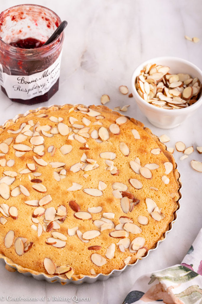 freshly baked bakewell tart on a marble surface
