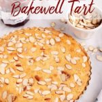 bakwell tart just baked cooling on a marble surface