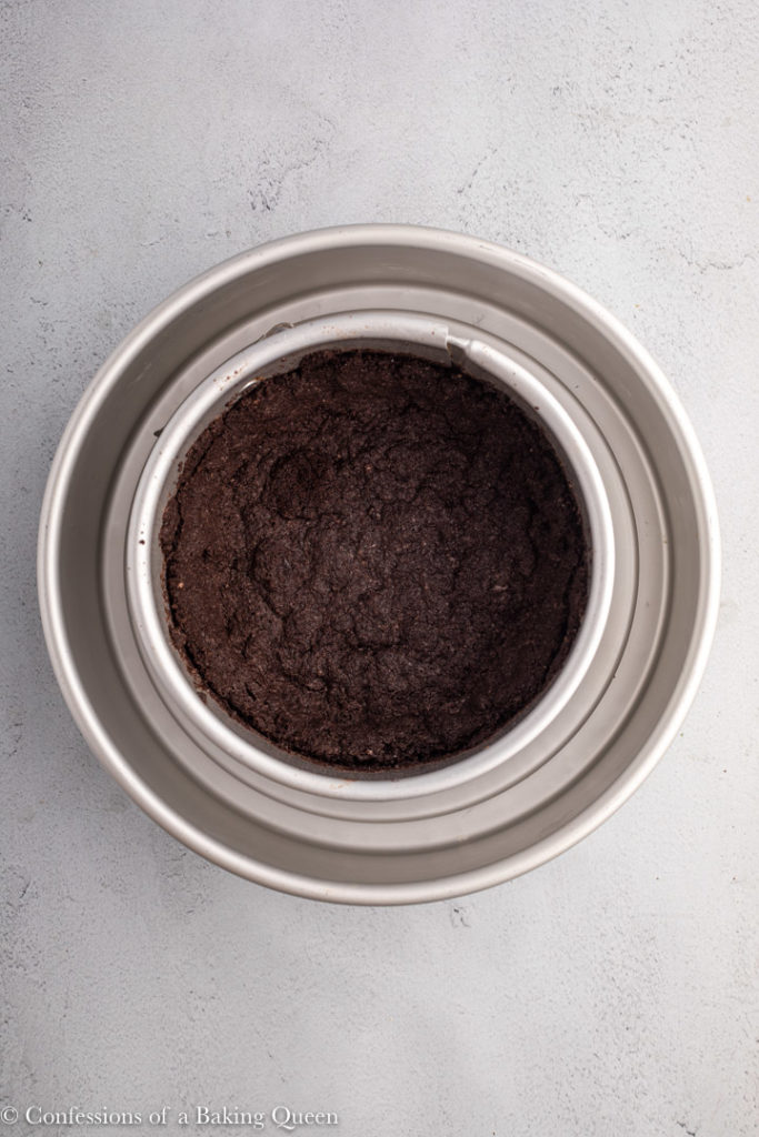 par baked oreo crust in a springform pan
