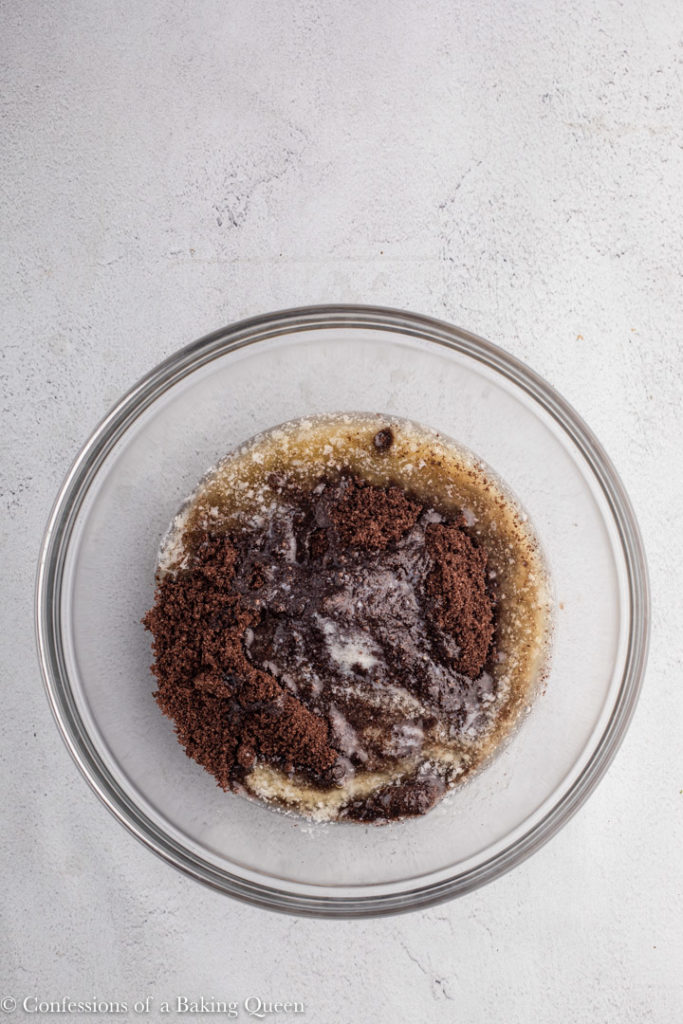 crushed oreo crumbs and melted butter in a small glass bowl