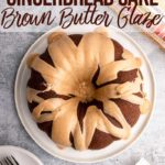 Gingerbread bundt cake with a brown butter glaze on a white plate