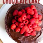 raspberry chocolate cake on a white serving platter