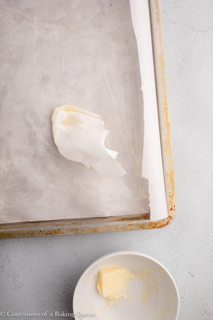 butter on a paper towel spread on to a parchment lined pan