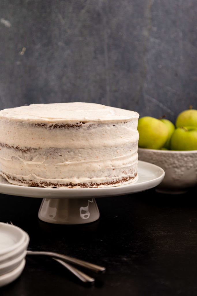 apple layer cake on a white cake stand