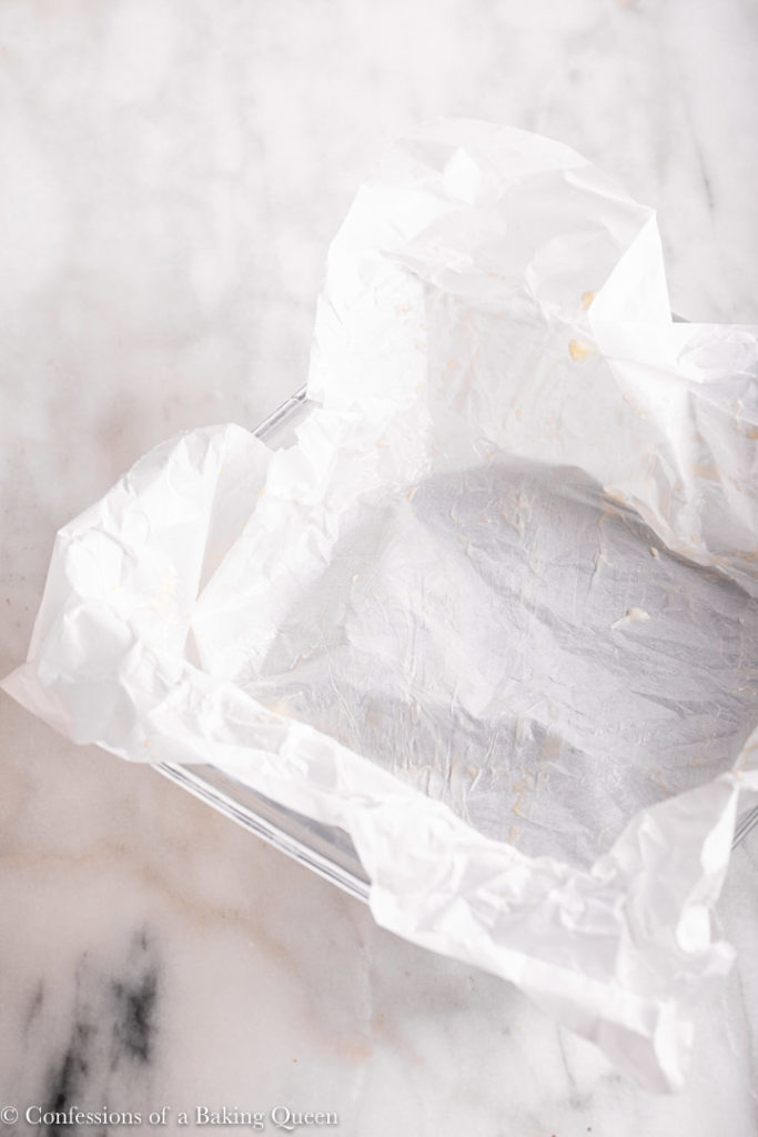 crumpled up piece of parchment paper greased with butter in a glass dish