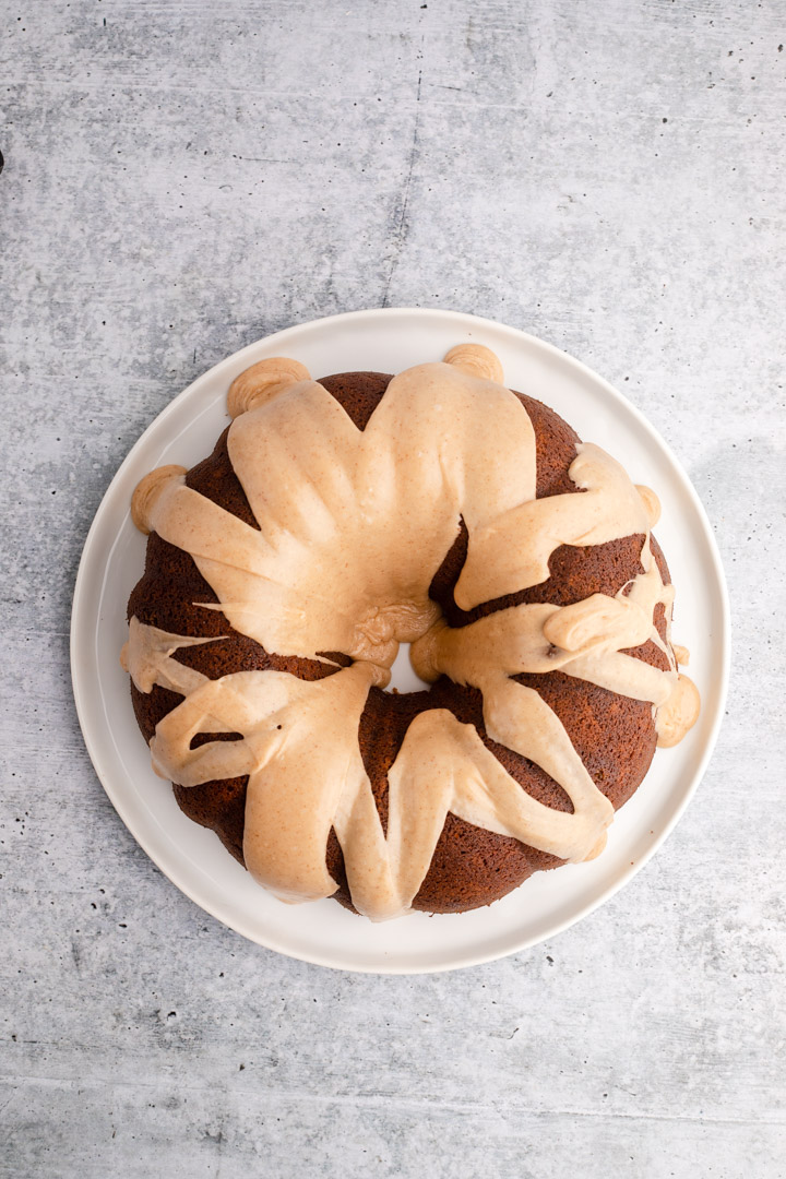 gingerbread bundt cake with a browned butter glaze on a white plate