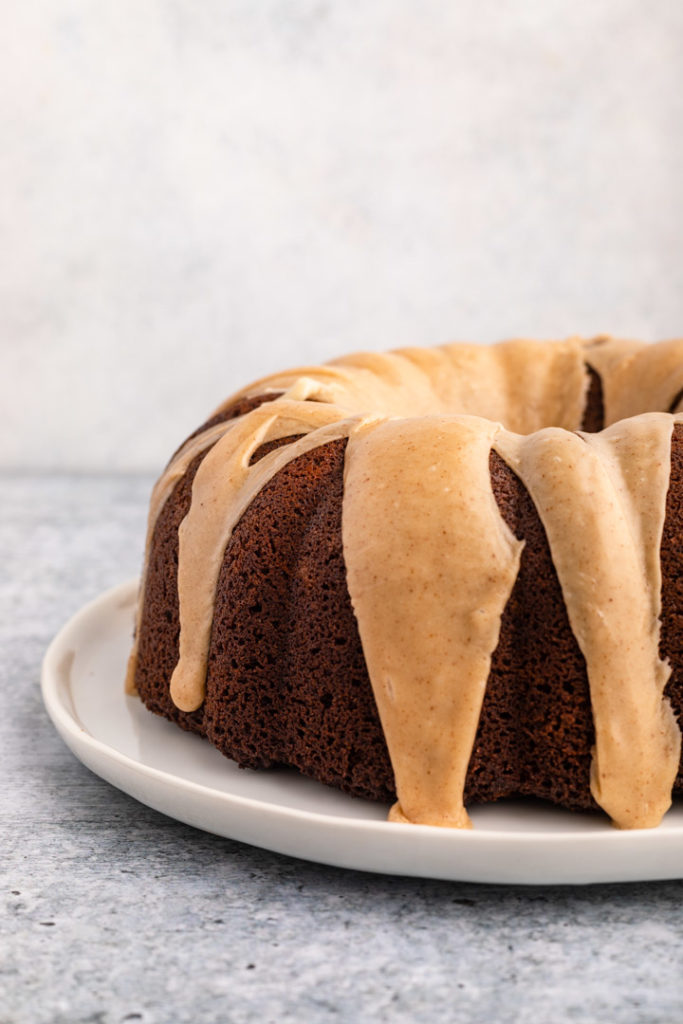 front view of a brown butter glazed gingerbread bundt cake