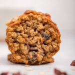 up close of a Oatmeal Cranberry Cookie on a white surface