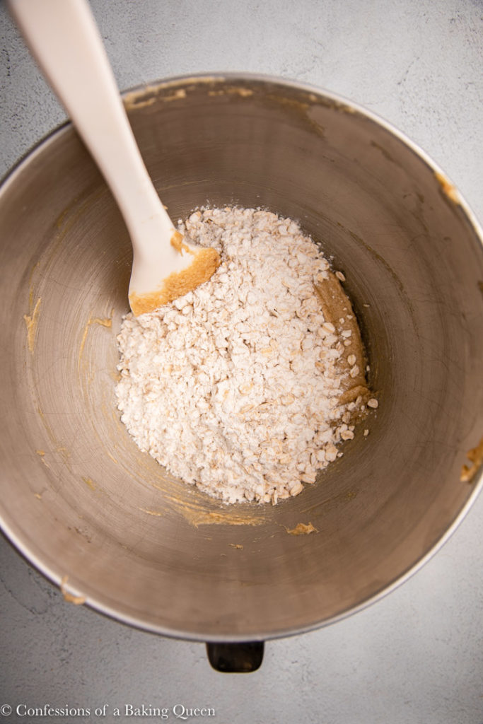 dry ingredients added to wet in a large metal bowl