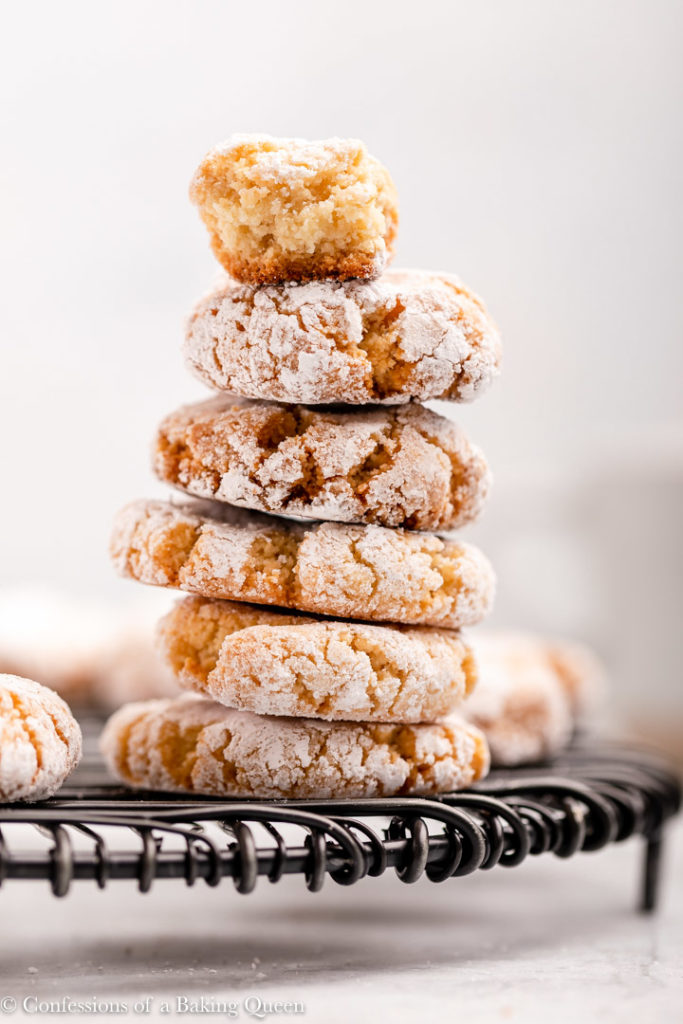 piece of an amaretti cookie stacked on top of more amaretti cookies