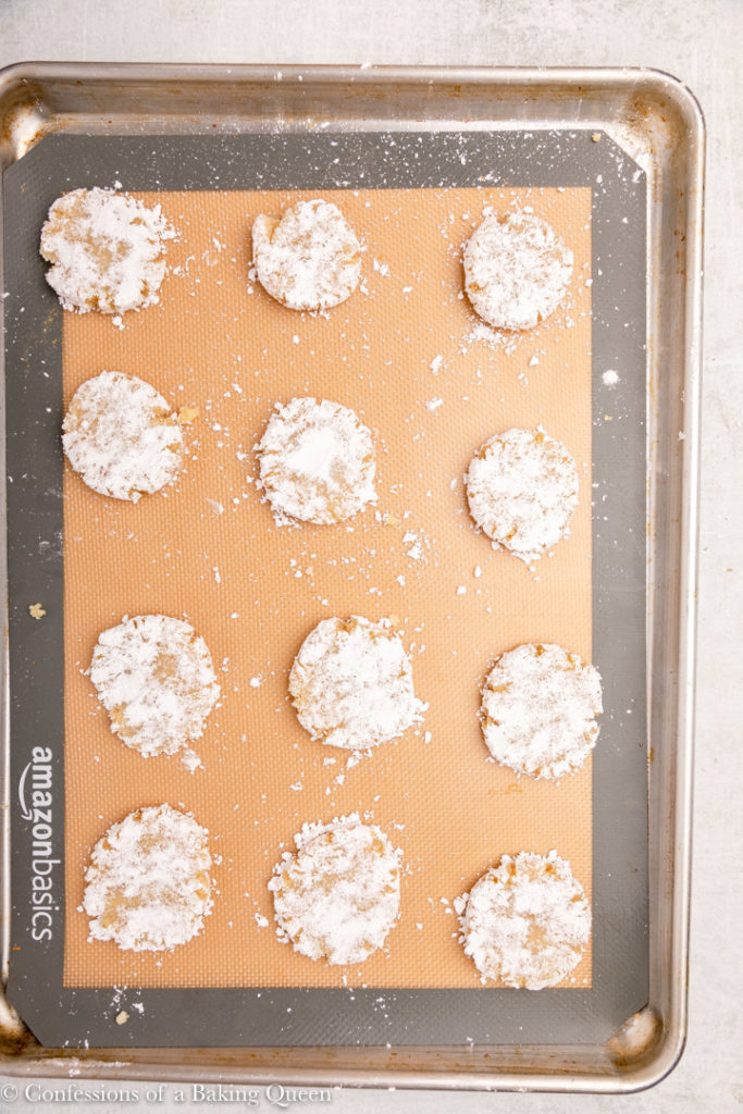 amaretti cookies on a silpat lined baking sheet before baking