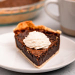 piece of chocolate chess pie with a dollop of whipped cream