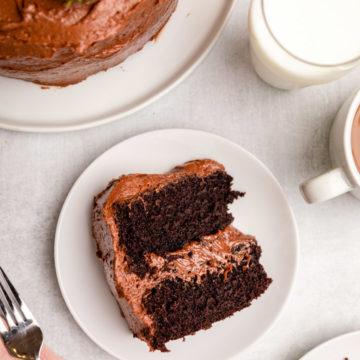 moist chocolate cake slice next to full cake