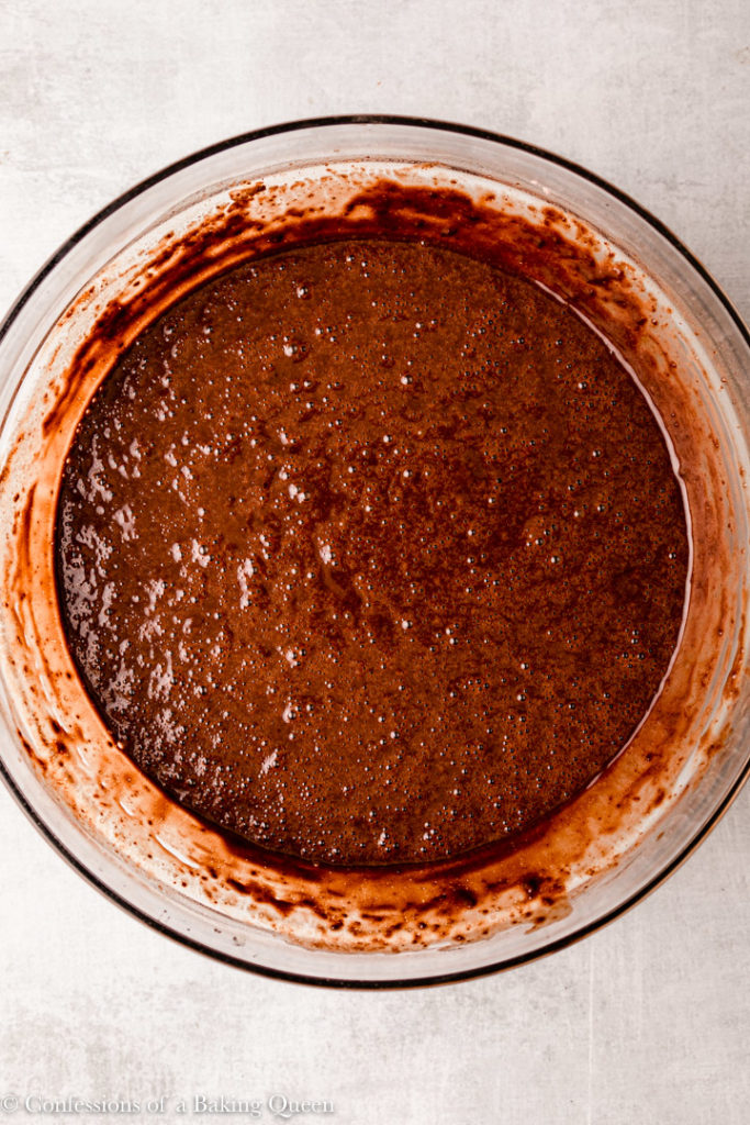 the best chocolate cake recipe batter in a large glass bowl
