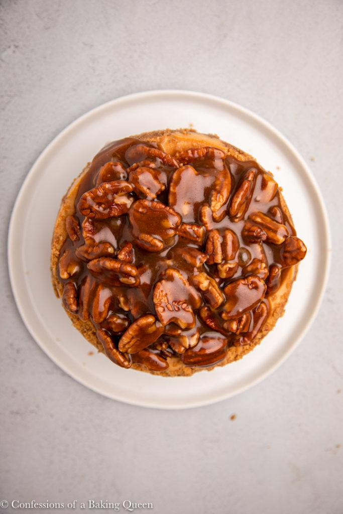 pecan pie cheesecake on a white plate