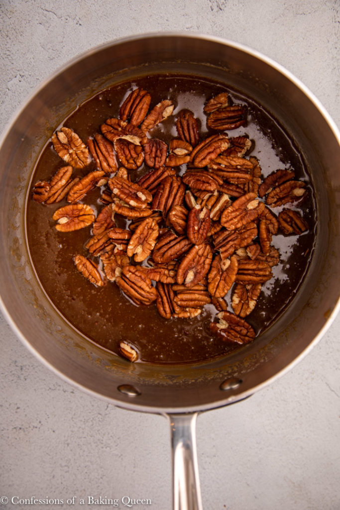 pecans added to caramel sauce in a large pot