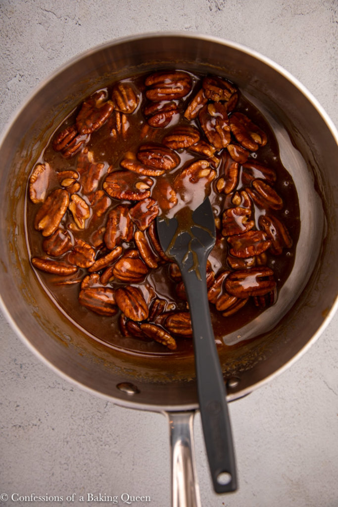 caramel pecan sauce in a large metal pot