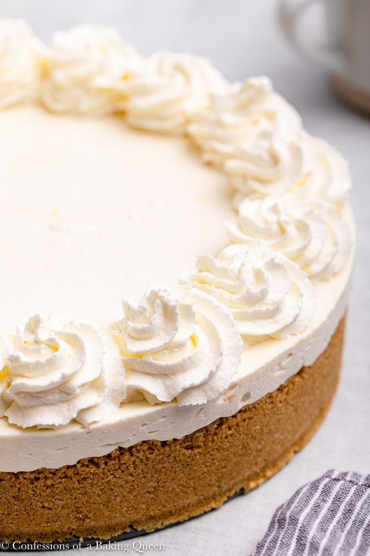 45 degree view of a no bake cheesecake with whipped cream