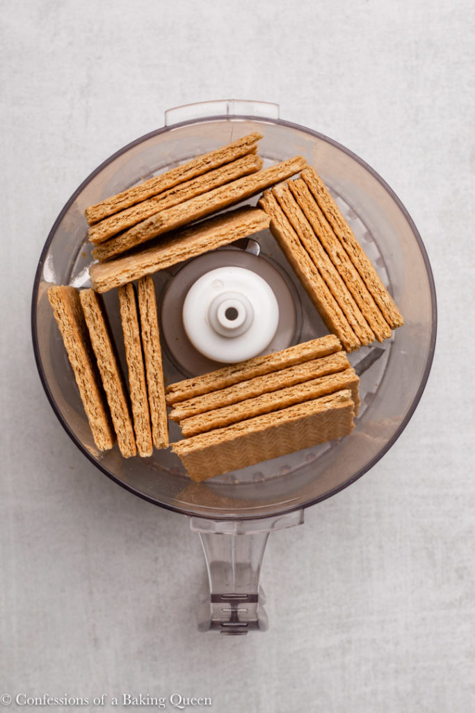 graham crackers in a food processor bowl