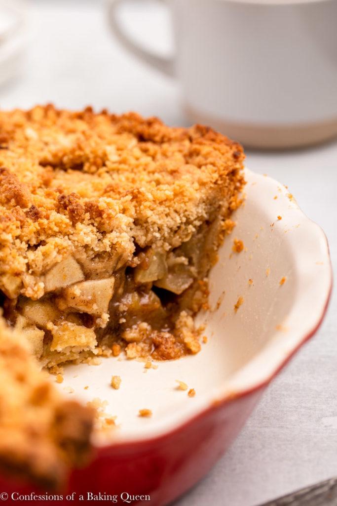 inside of a dutch apple pie in a red pie dish