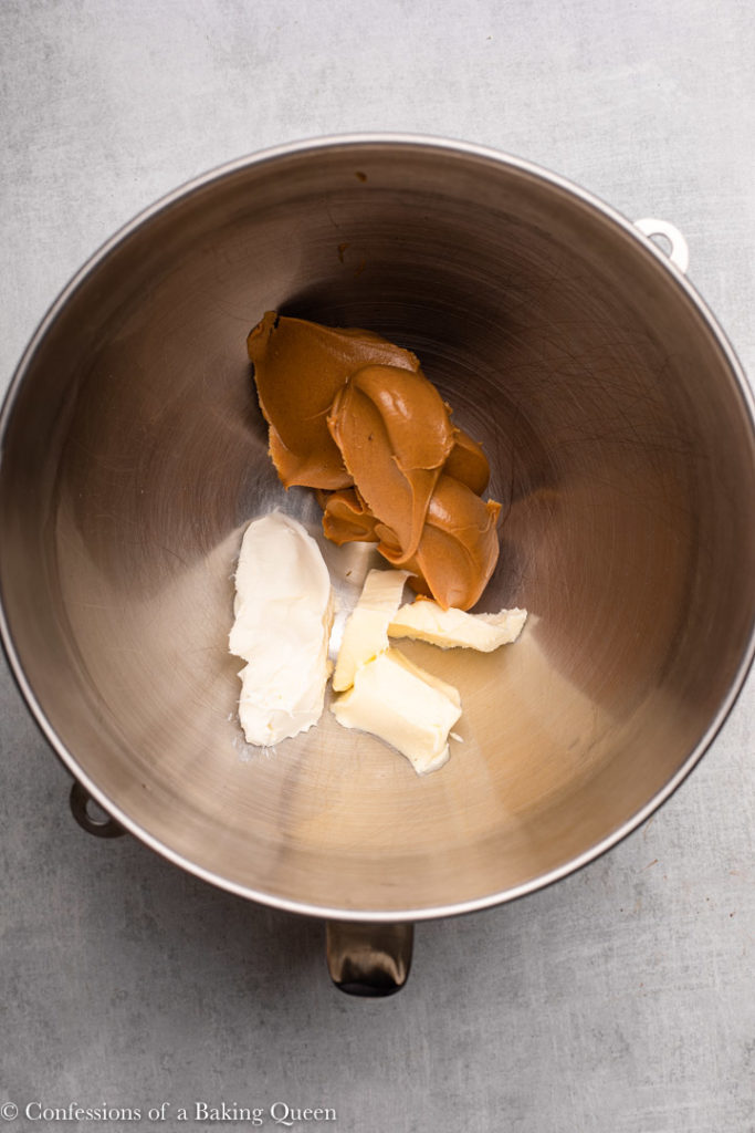 peanut butter, butter, and cream cheese mixed together in a metal bowl