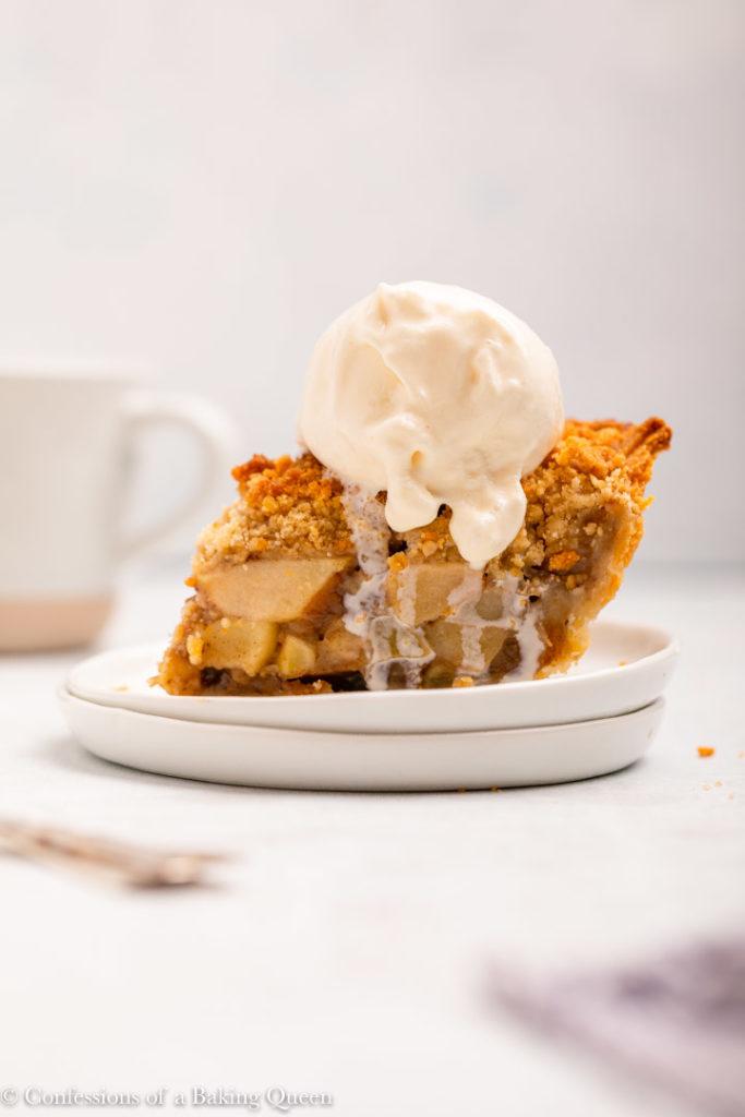 slice of dutch apple pie a la mode on a white plate