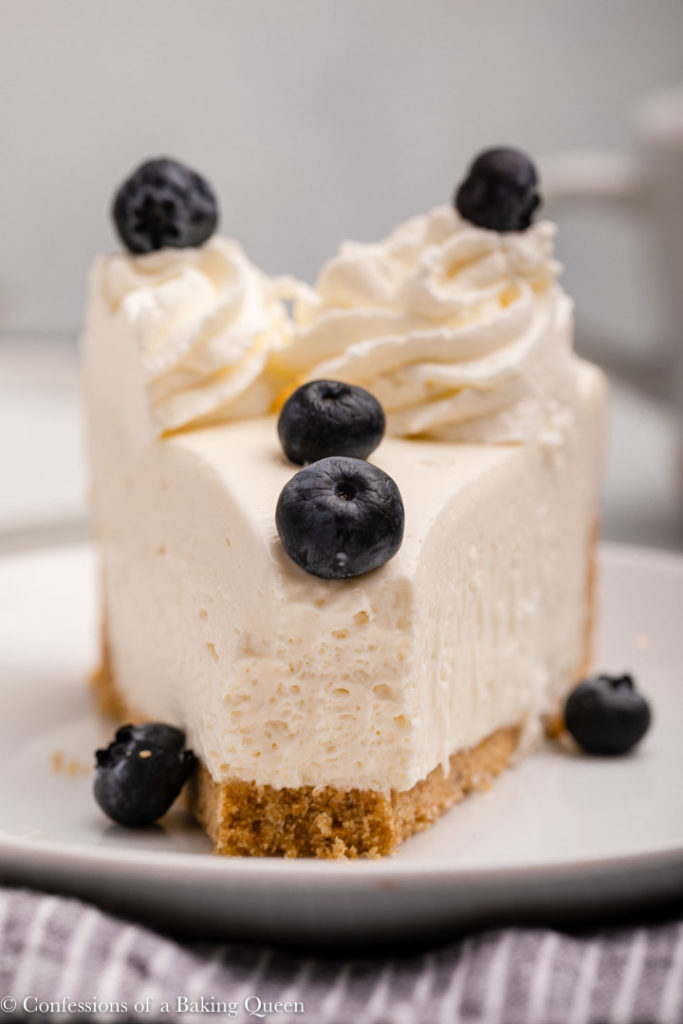 slice of no bake cheesecake with blueberries on top