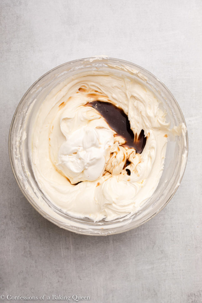 sour cream, vanilla and lemon juice added to sugar cream cheese mixture in a large glass bowl