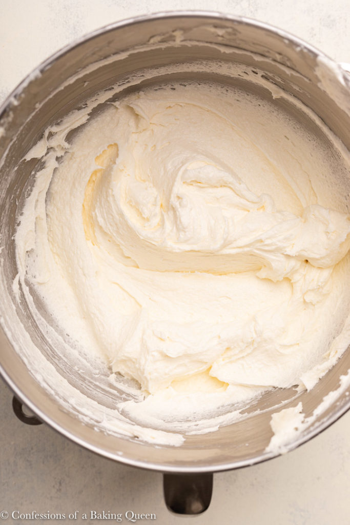 butter, cream cheese, and sugar whipped together in a metal mixing bowl