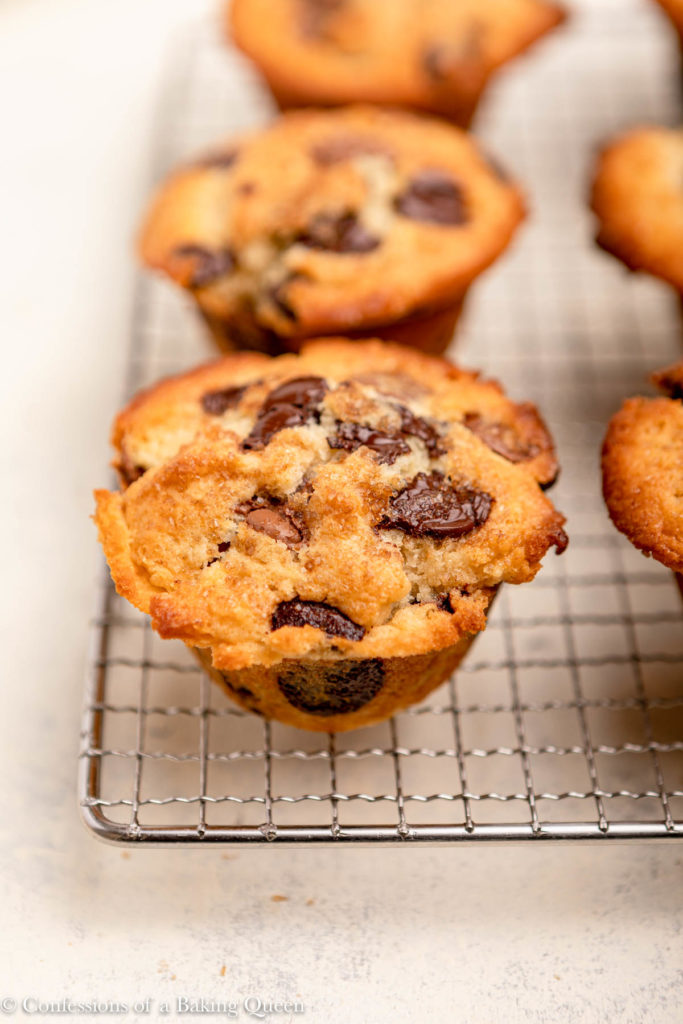 chocolate chip muffins baked and cooling on a wire rack