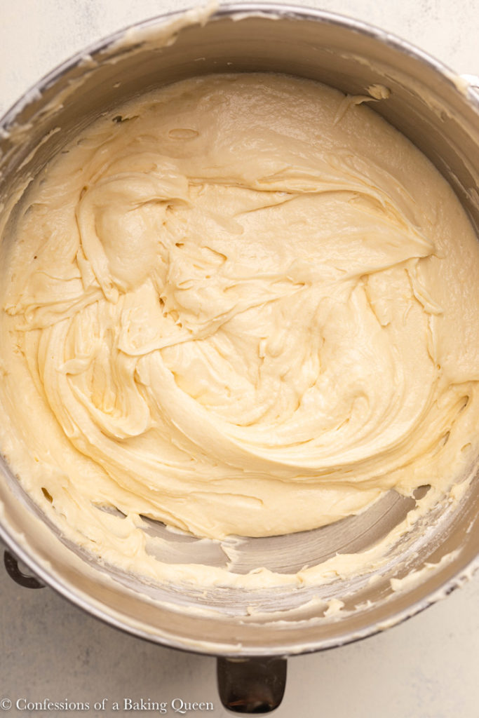 cream cheese pound cake batter in a large metal mixing bowl