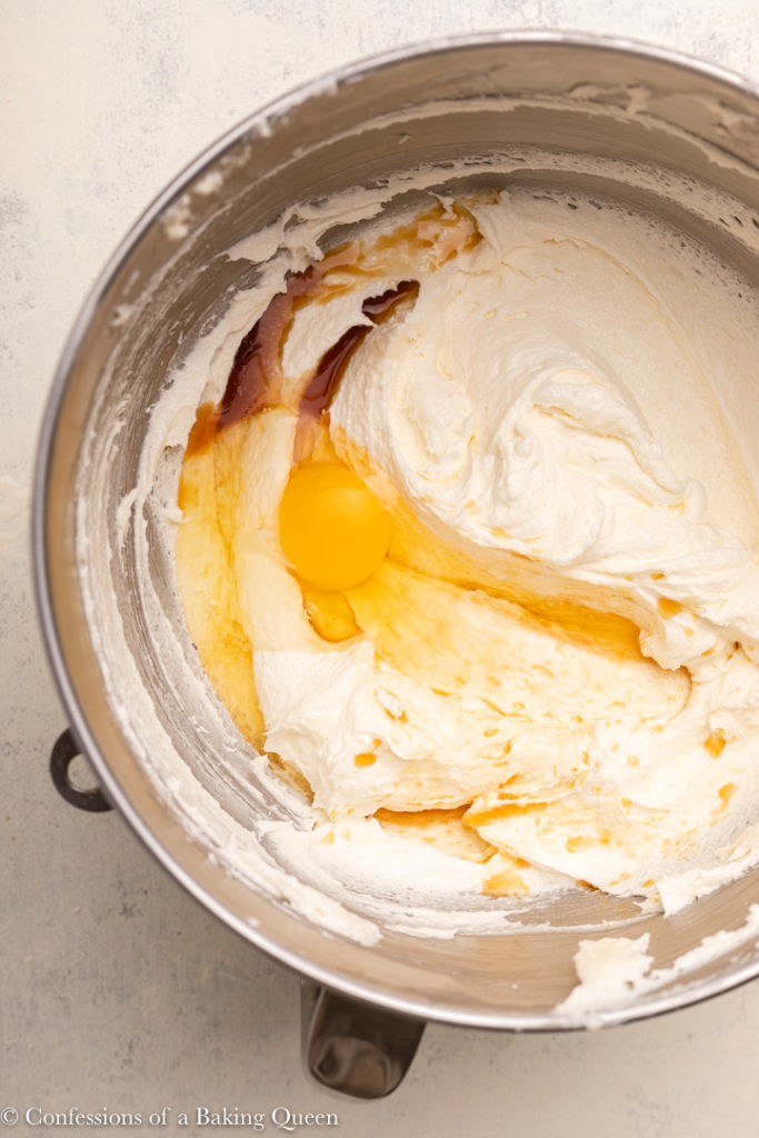 egg and vanilla extract added to creamed butter and sugar in a metal mixing bowl