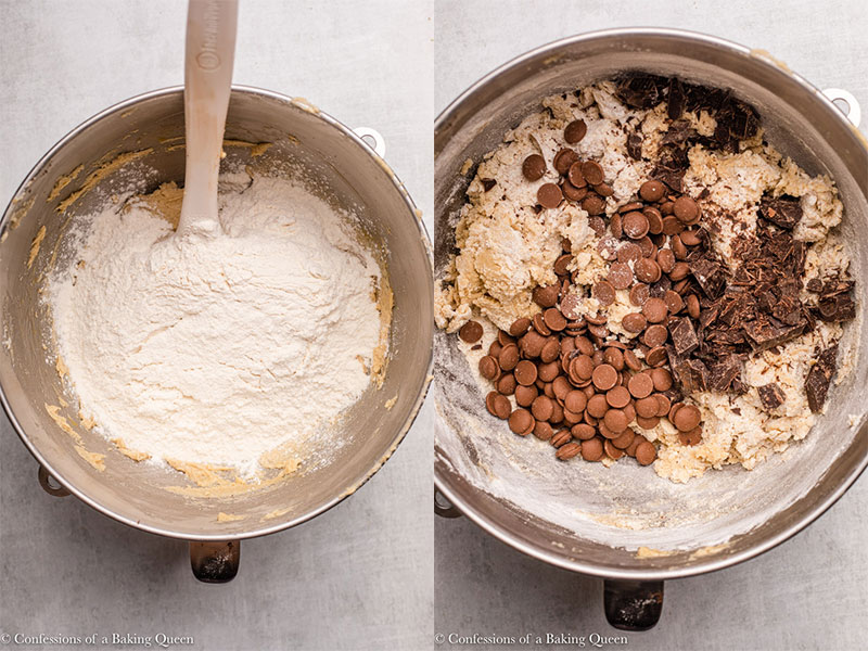 flour and chocolate chips added to cookie dough in a metal bowl