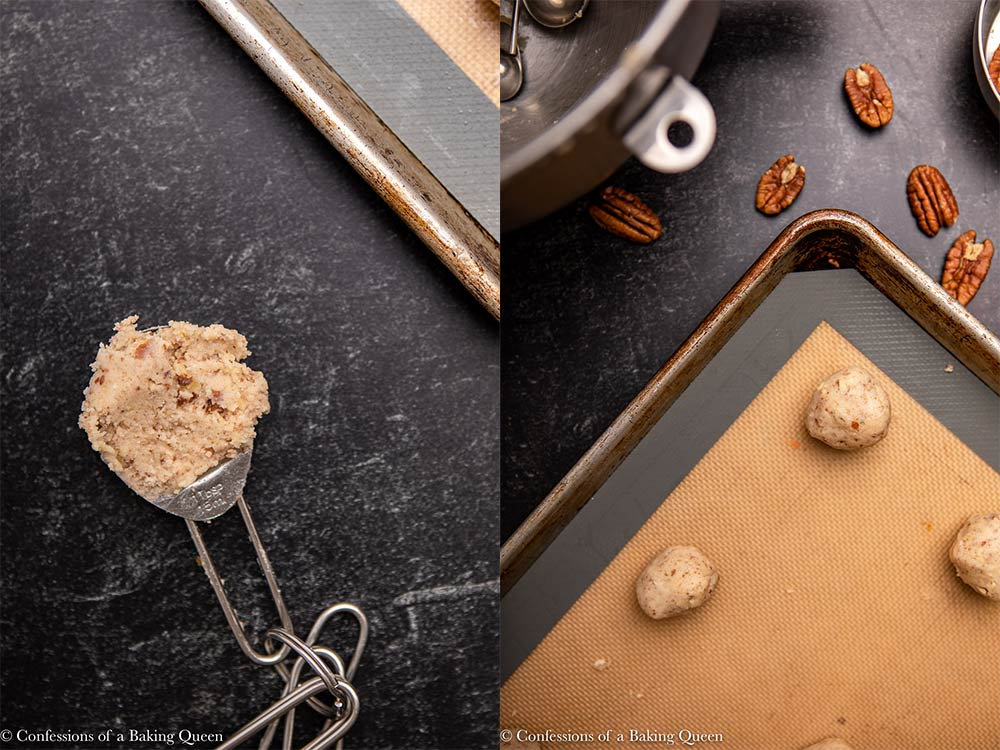 mexican wedding cookie dough scooped into a ball on a silpat lined baking sheet