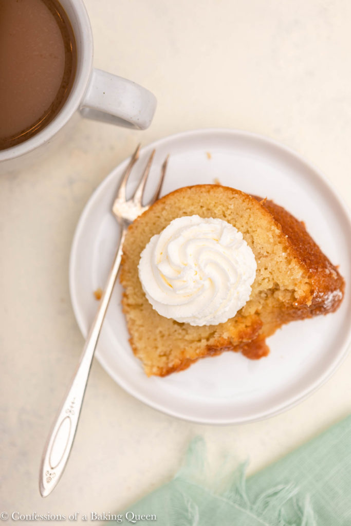 slice of kentucky butter cake with whipped cream on a white plate