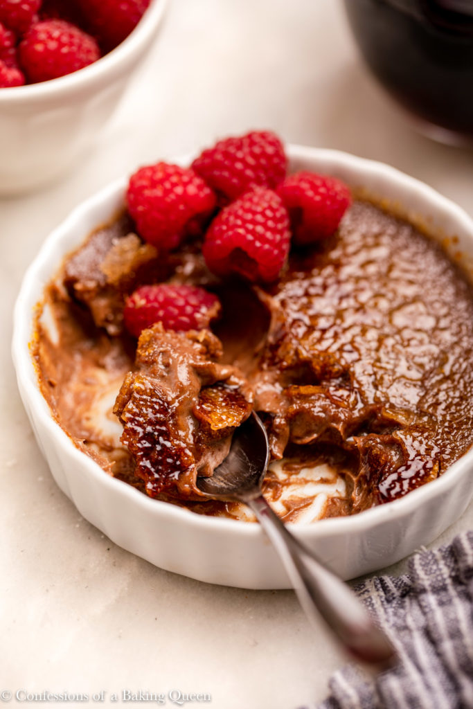 spoon taking a bite of chocolate creme brulee