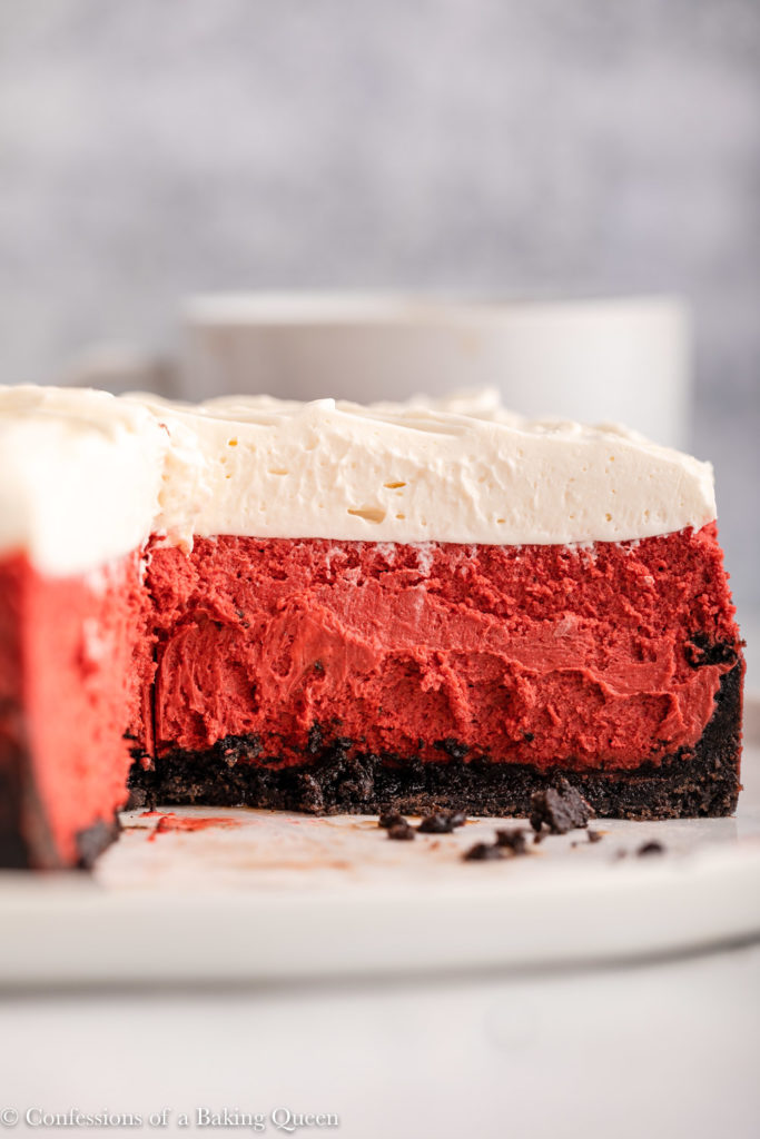 inside of a cut open red velvet cheesecake on a plate